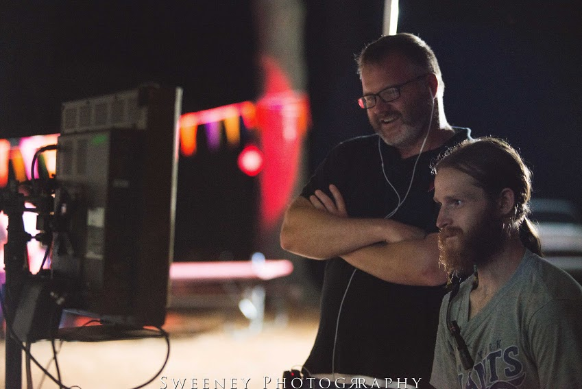 Jacob ( left)  watching the scene on set