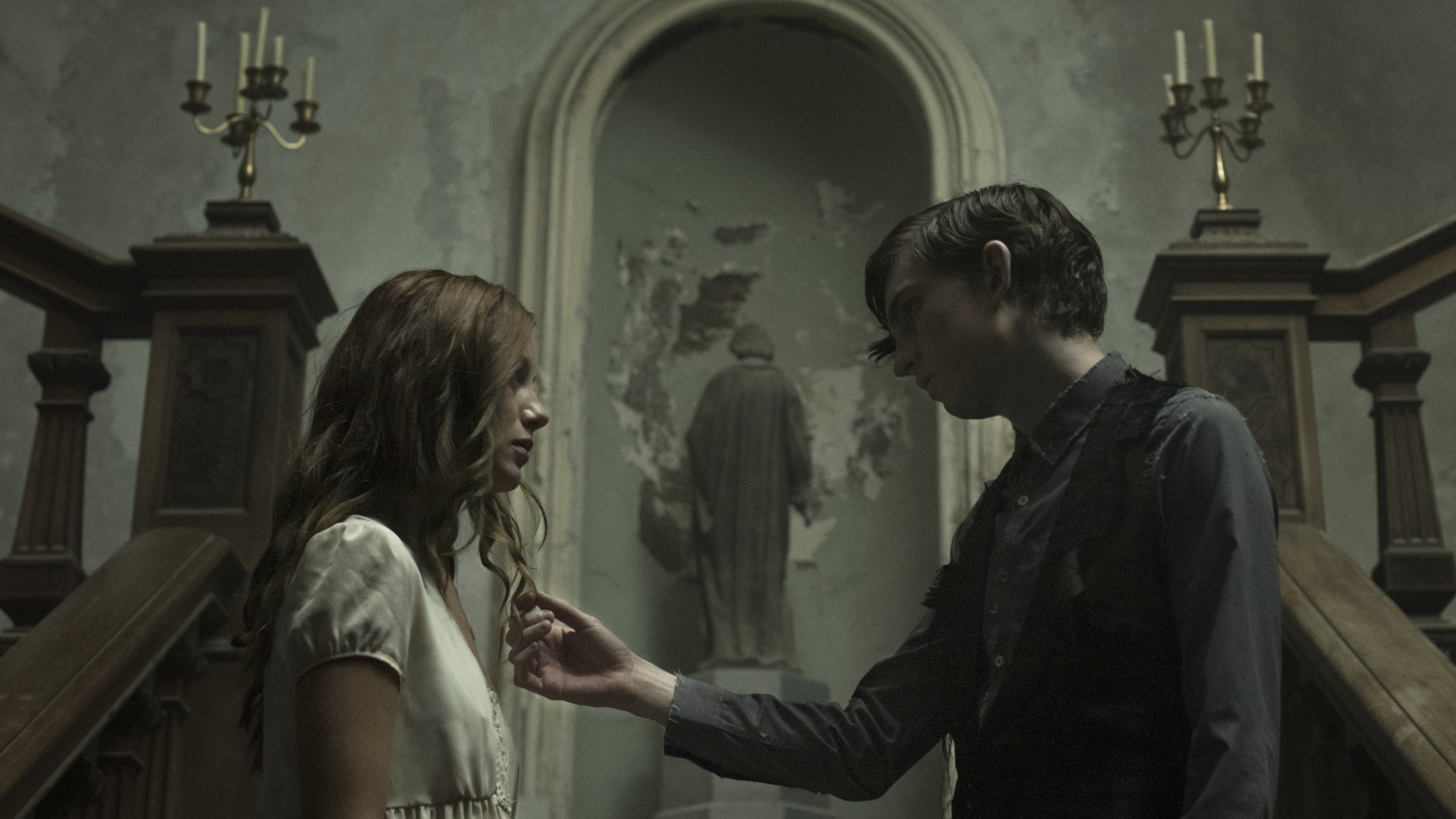 """[L-R] Charlotte Vega as Rachel and Bill Milner as Edward in the gothic horror film  """"THE LODGERS.""""  Photo courtesy of Martin Maguire."""