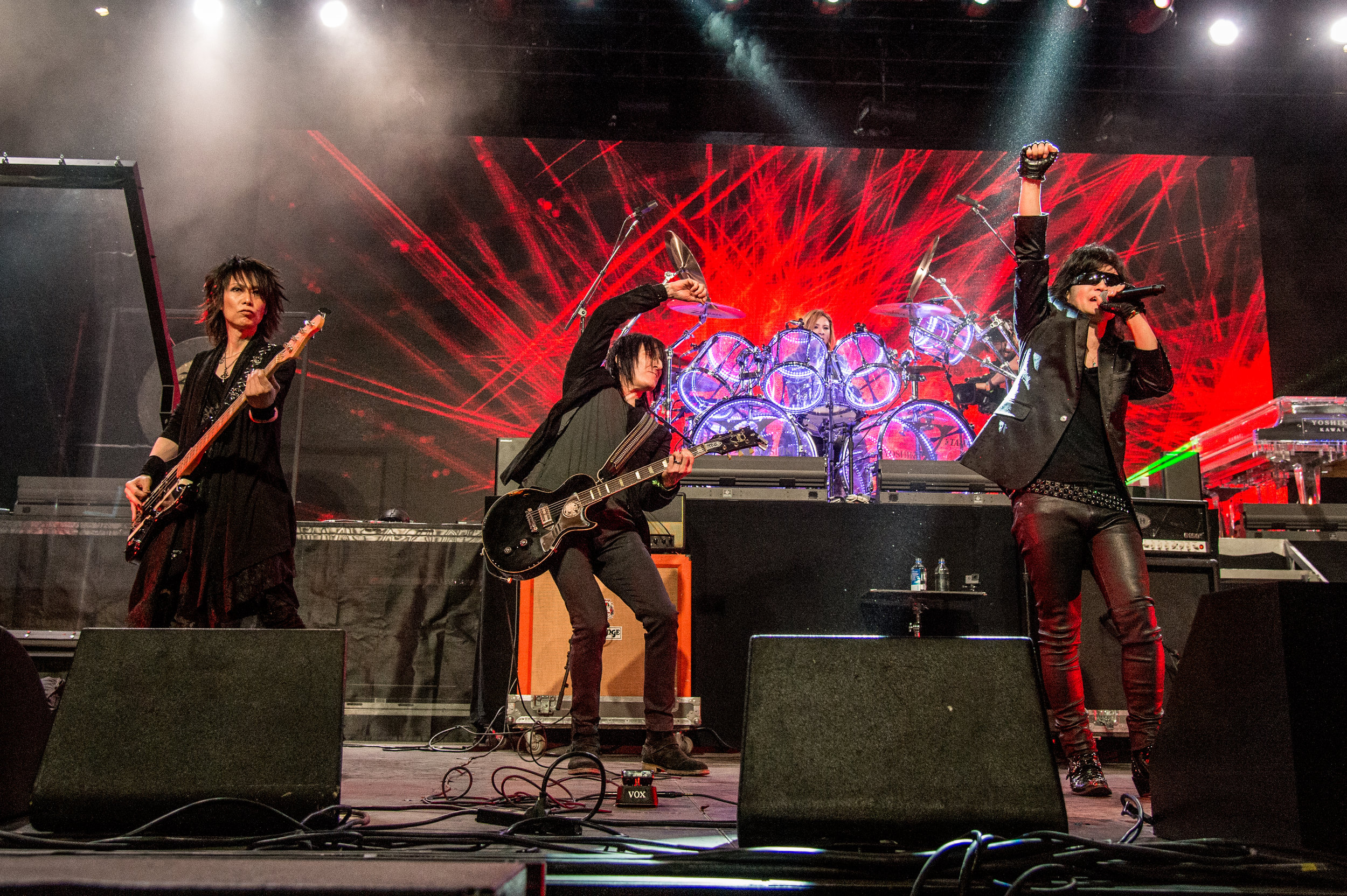 Photo L-R: Heath of X Japan, Richard Fortus (Guns N' Roses) and Toshi of X Japan perform at Coachella - Photo courtesy of Prime PR Group, INC