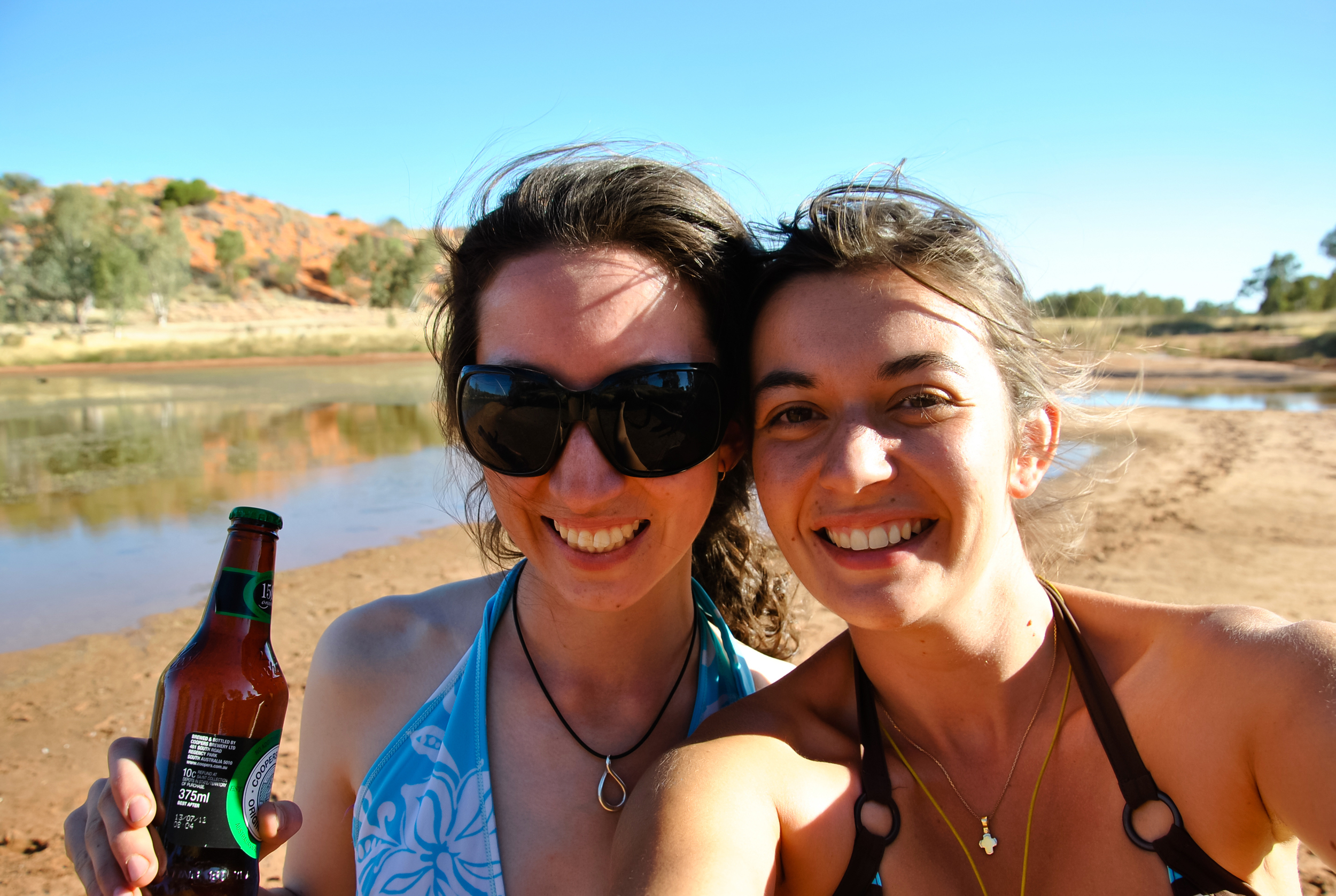 ...and the girls enjoying a Finke River waterhole after a long, hot day's digging.