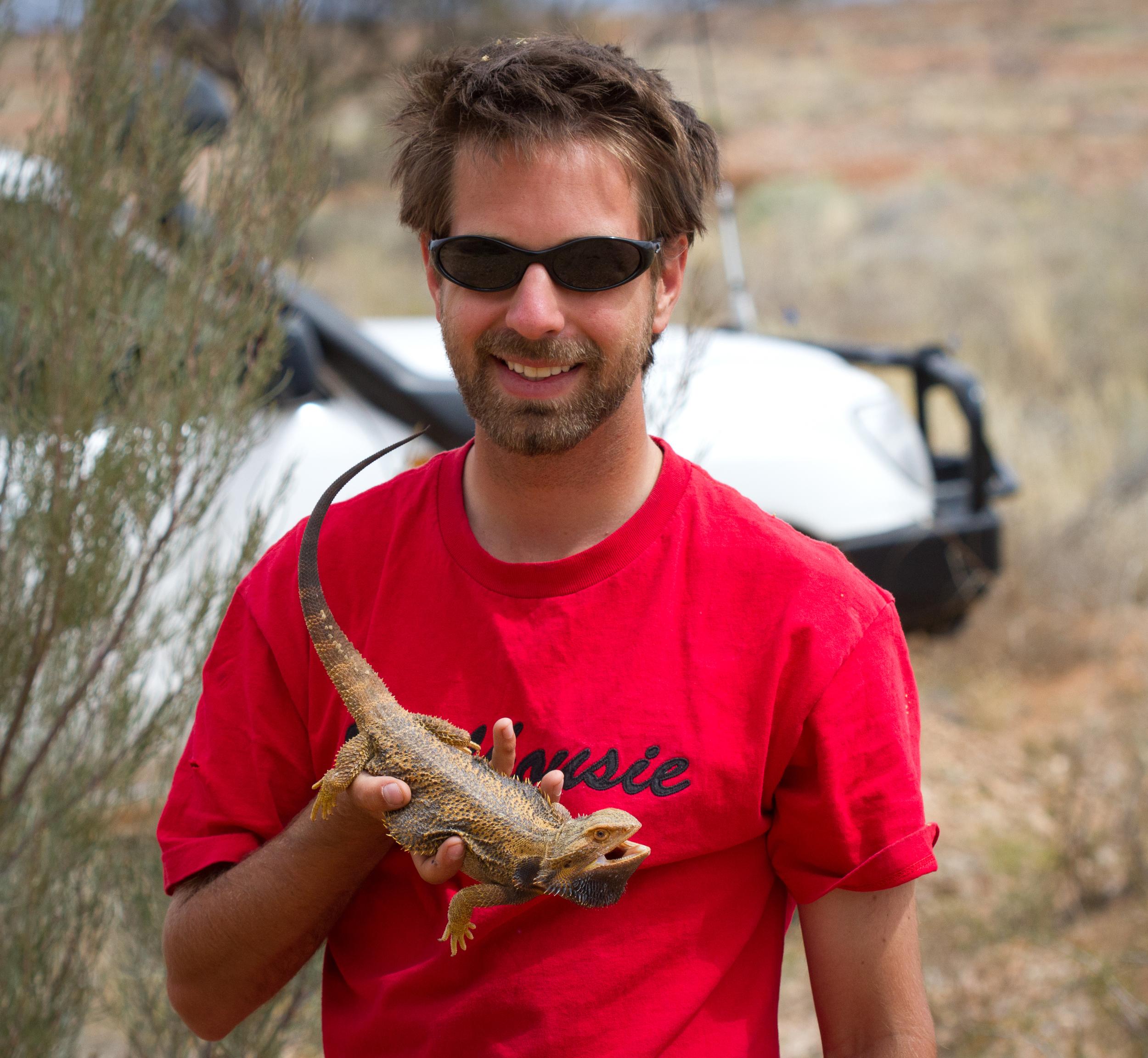 Me with a central bearded dragon ( Pogona vitticeps ). Anna Creek Station, South Australia, 2011. Photo by Angus Kennedy.