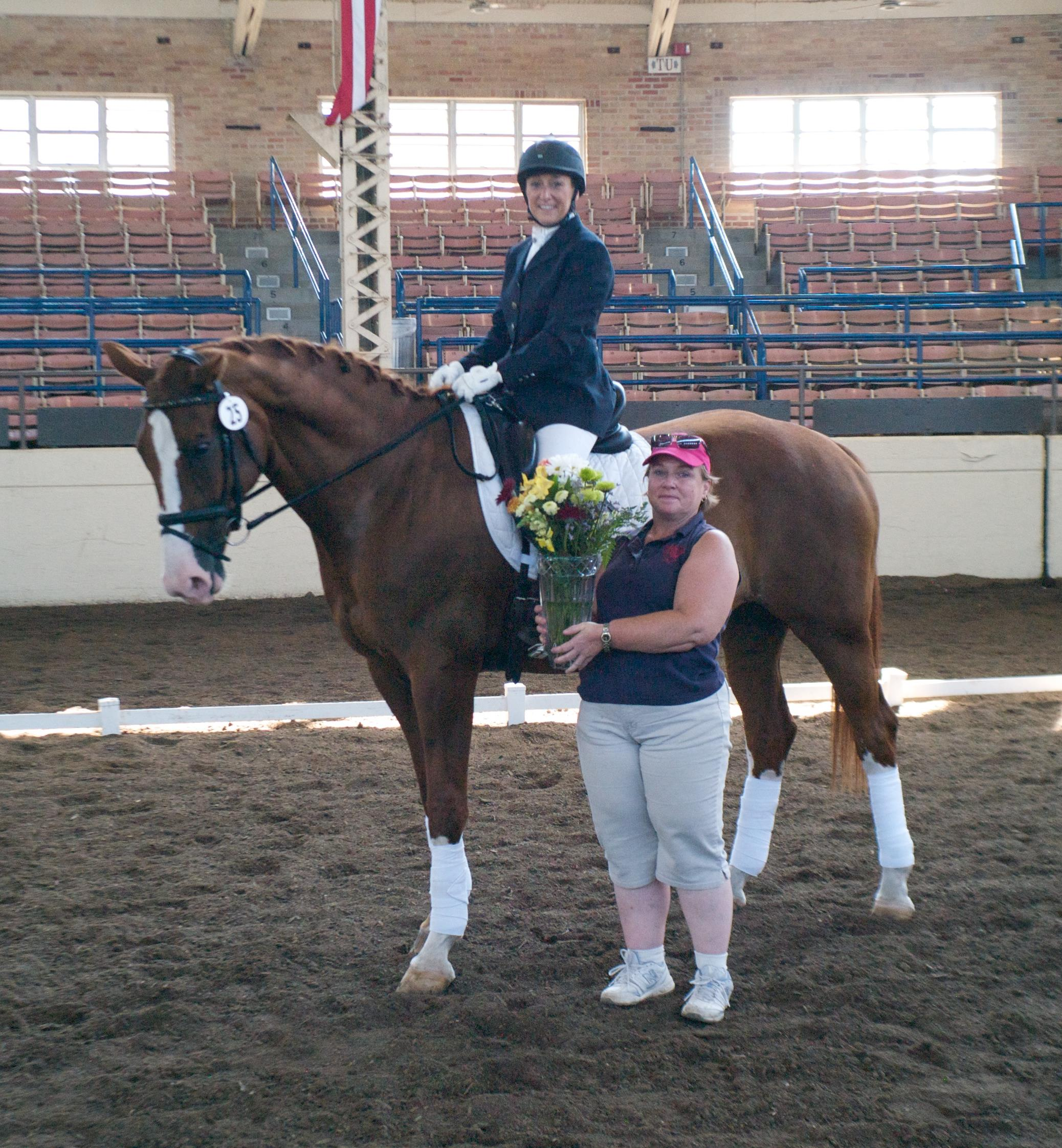 CLD Vice-President Judy Nordstrom atop Ghinger Ale with Paula Briney presenting the Cheryl Finke Memorial Award for Highest Scoring Freestyle    (photo by Steve Todd, Studio 131)
