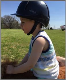 President Nordstrom's grandson Roman Parker on Easter riding Spirit. Next year leadline classes!