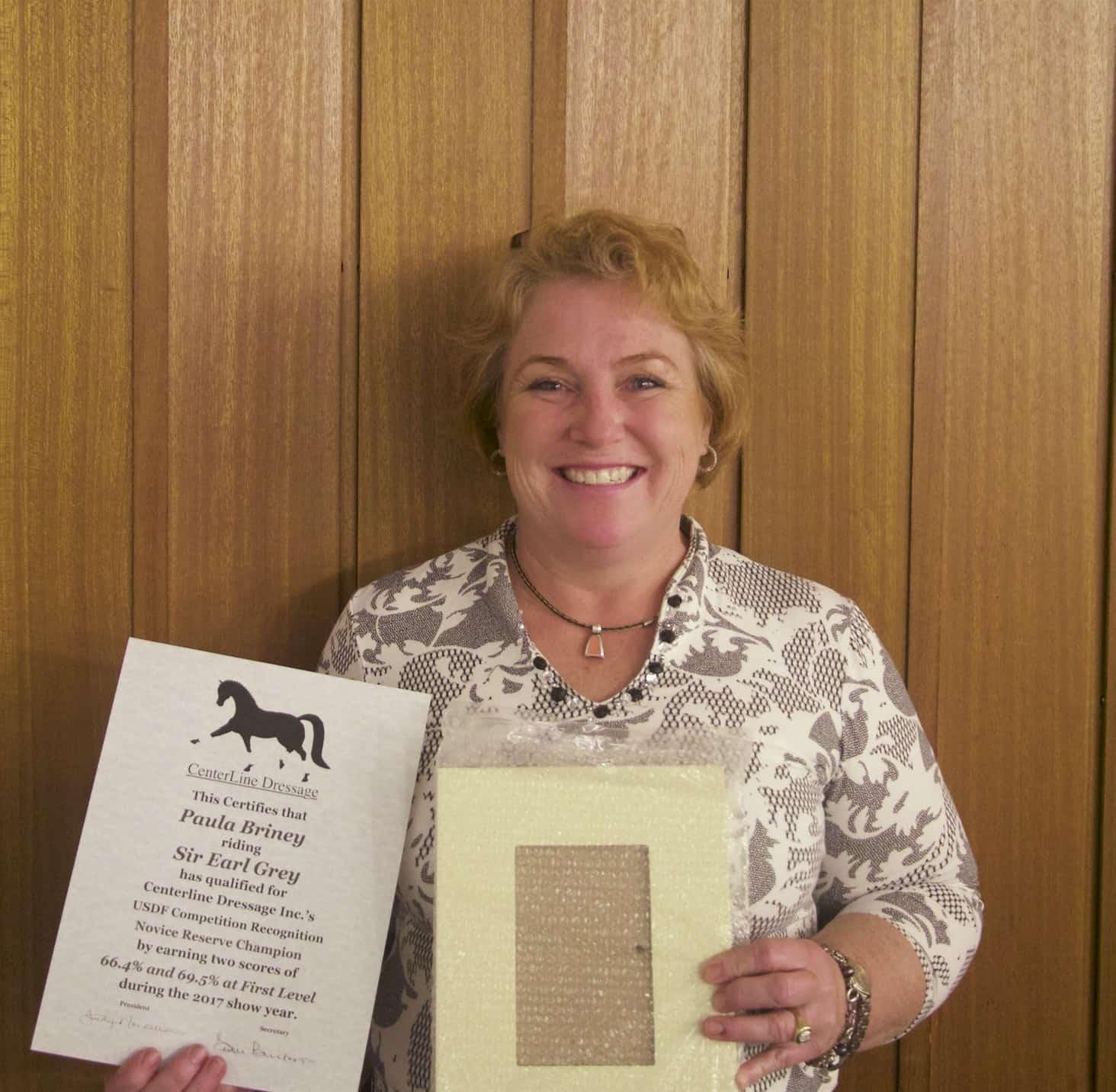 Paula Briney accepts an award