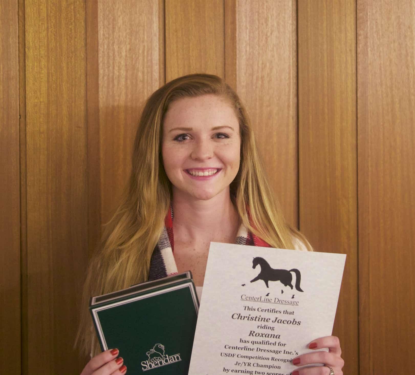 Christine Jacobs accepts an award