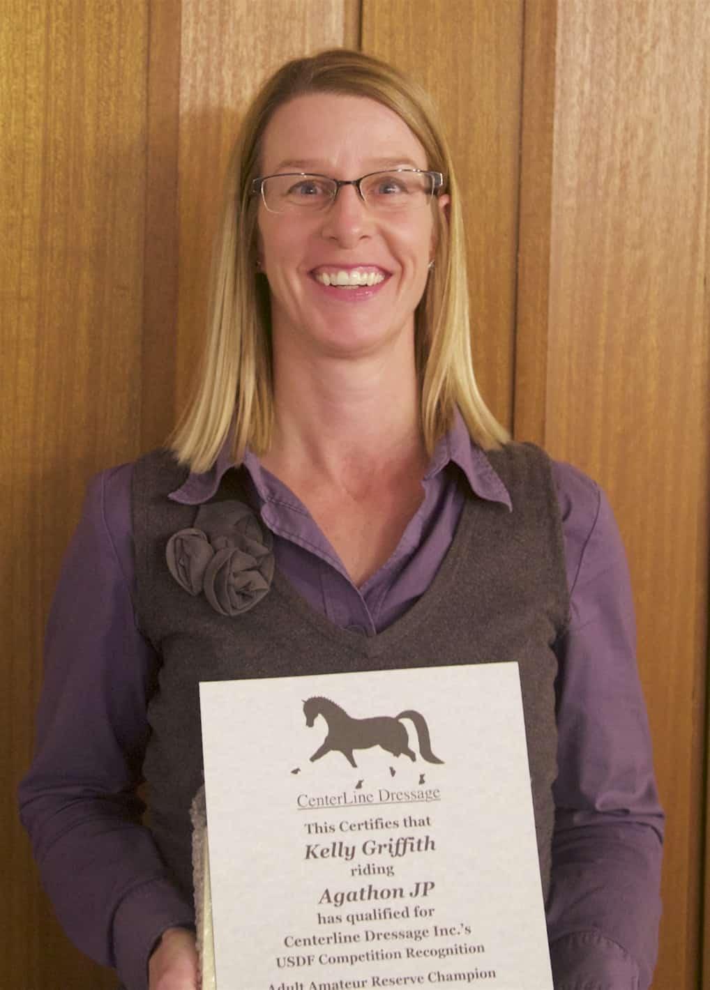 Kelly Griffith accepts an award