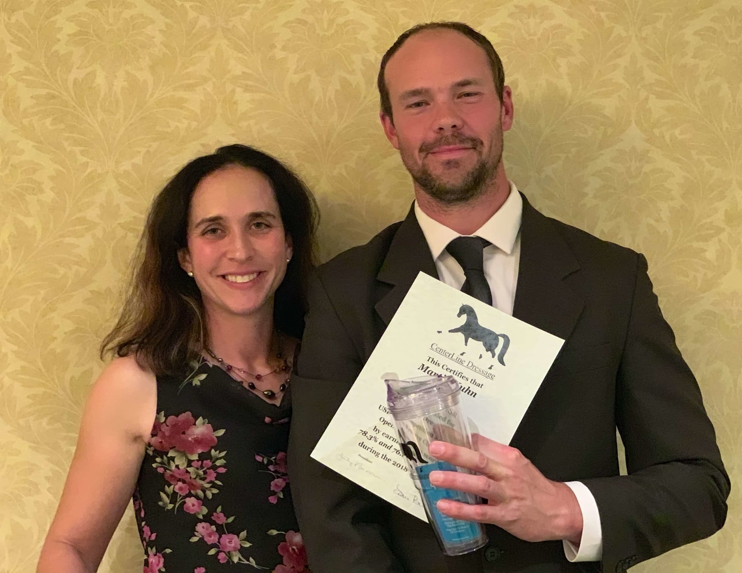 Kate Fleming-Kuhn & Martin Kuhn receiving an award
