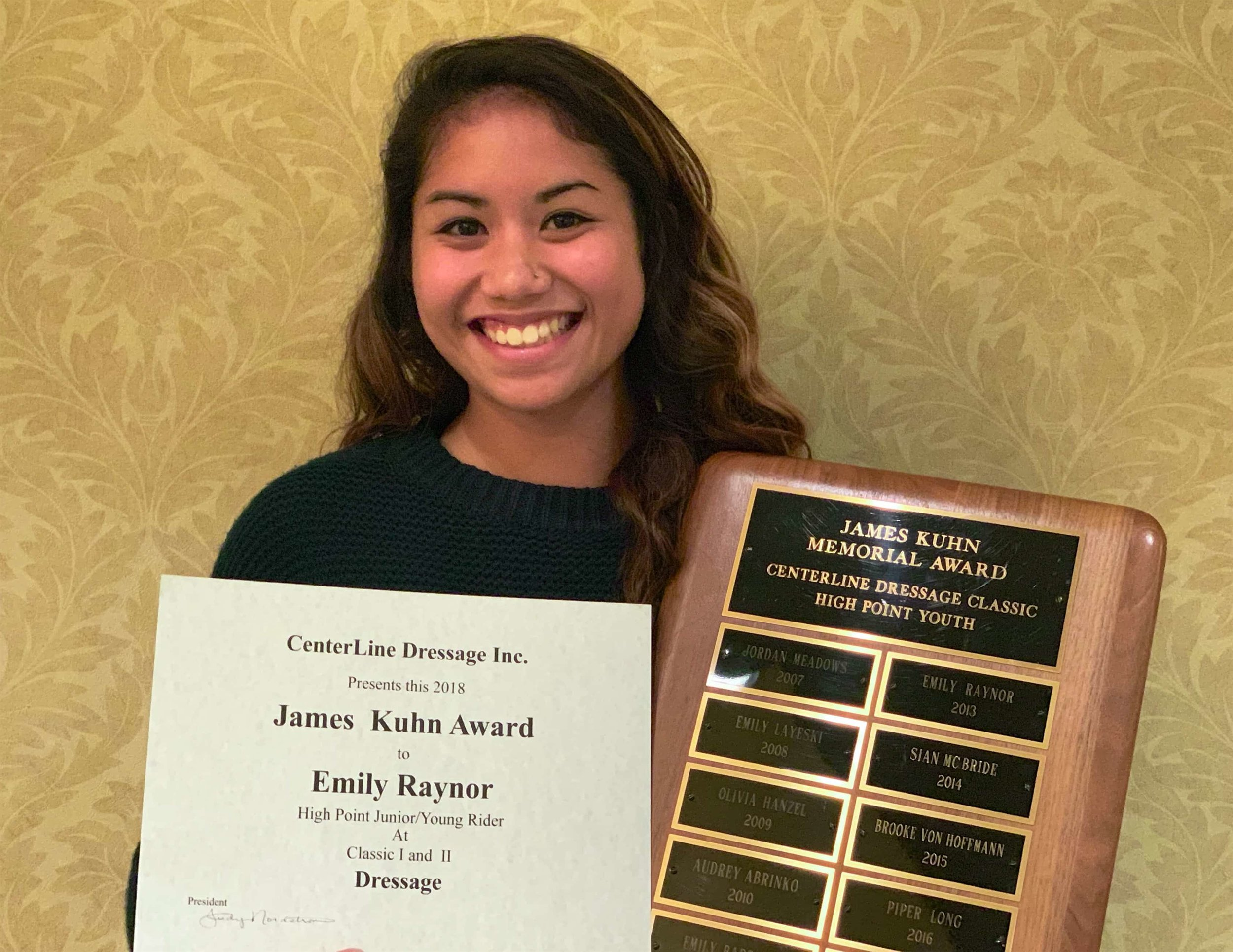 Emily Raynor receiving the James Kuhn Memorial Award for the second time