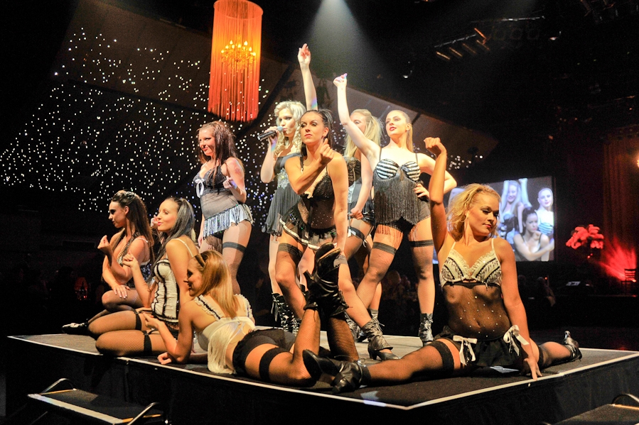 BURLESQUE - Captivating. Sensual. Empowering. Seductive. A mass of gorgeous bodies fill the stage costumed in iconic Parisienne style costumes.