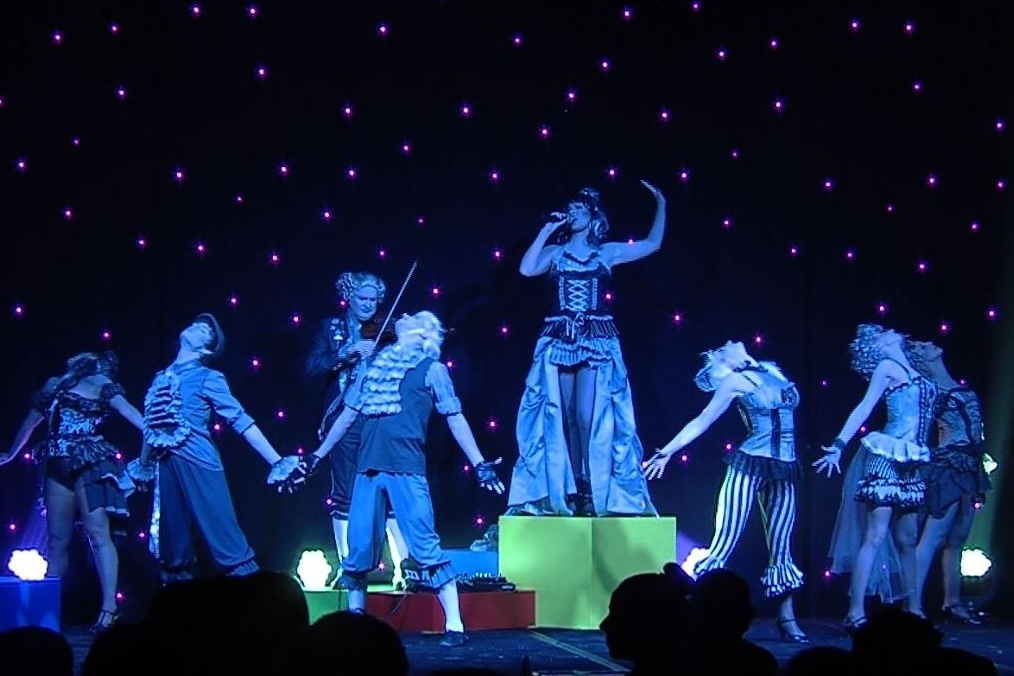 POP CLASSIQUE - Blending classical violin with pop, voice, dance, pole artistry, acro and rope aerial. Steampunk inspired costuming creates a monochromatic illusion.