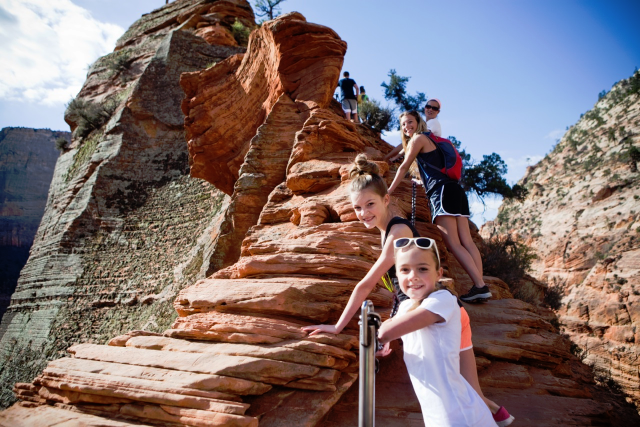 Haslams and Carmens  USING  their fitness on Angel's Landing.