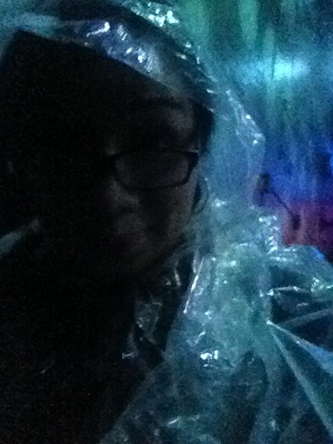 A picture of me overly excited to be in a poncho.