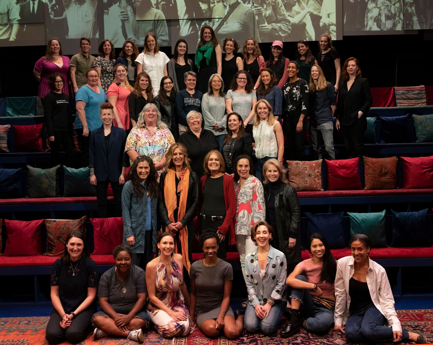 source  - Gloria Steinem is actually in this picture: second row from the bottom, in the middle in a red cardigan.
