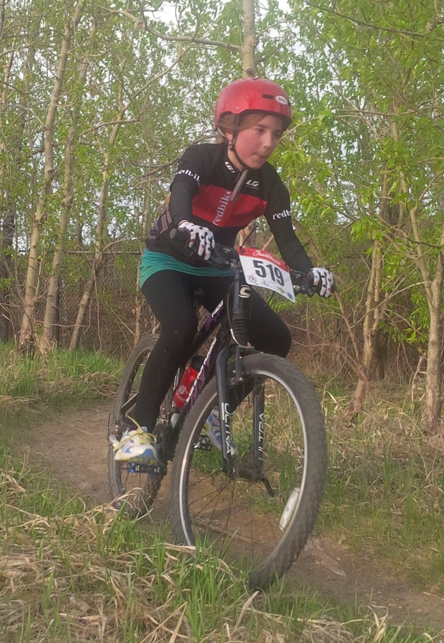 Annie racing to a podium spot in the Geared Girls race.