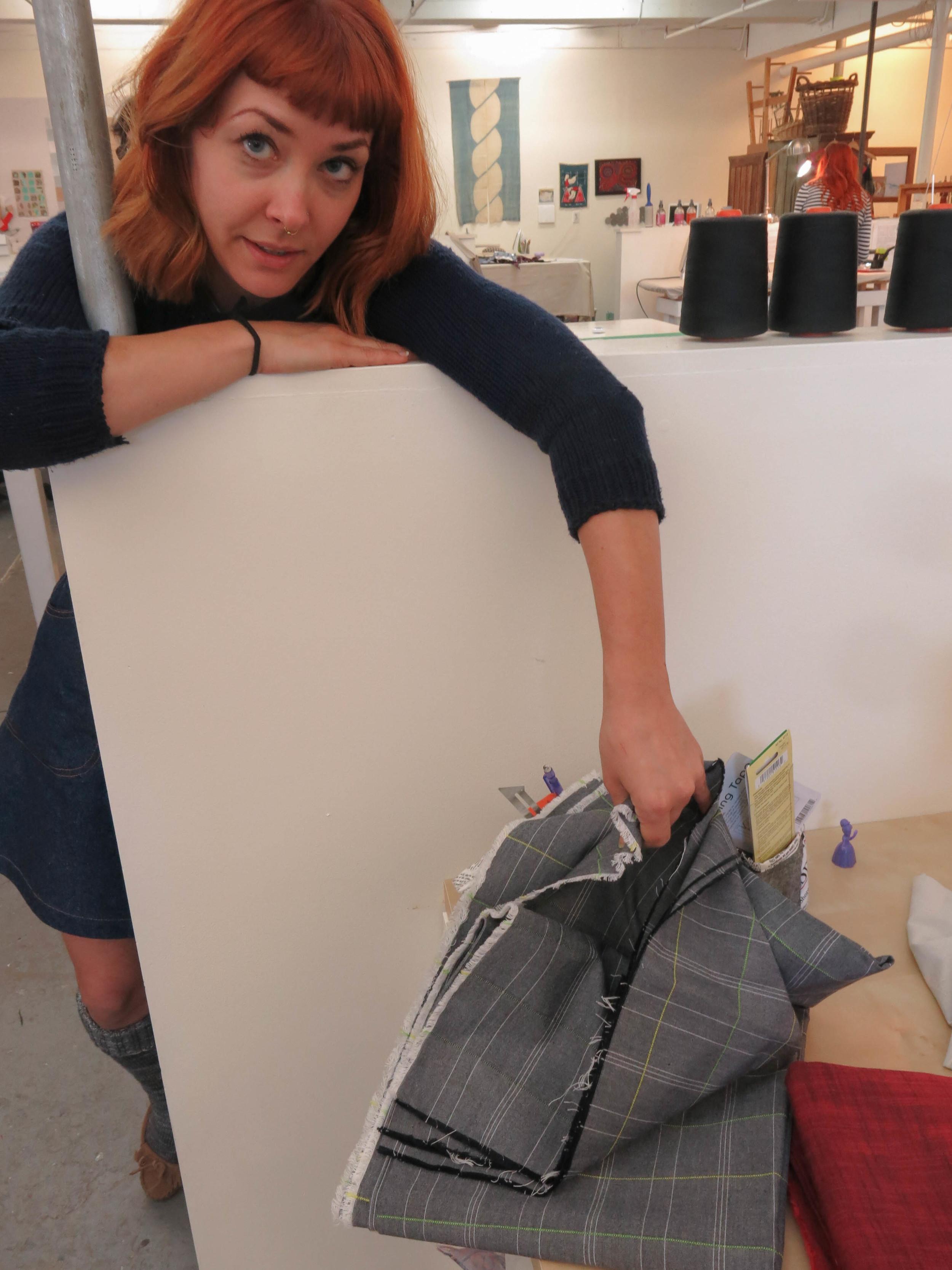 Lauren touches fabric (1 of 1).jpg