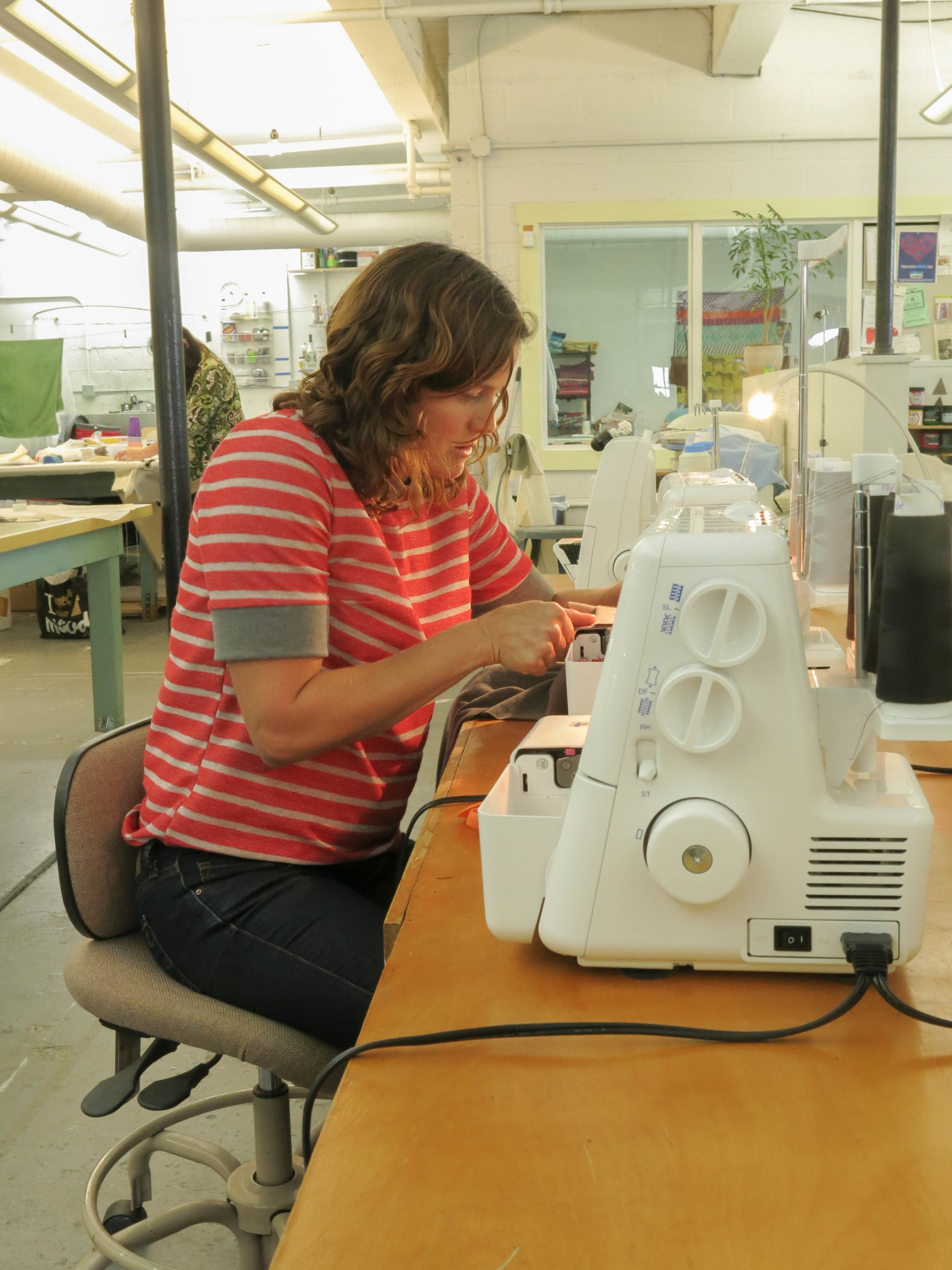 Katie on the serger (1 of 1).jpg