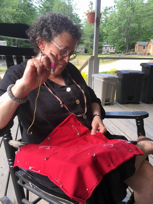 Ellen stitching on the porch (1 of 1).jpg