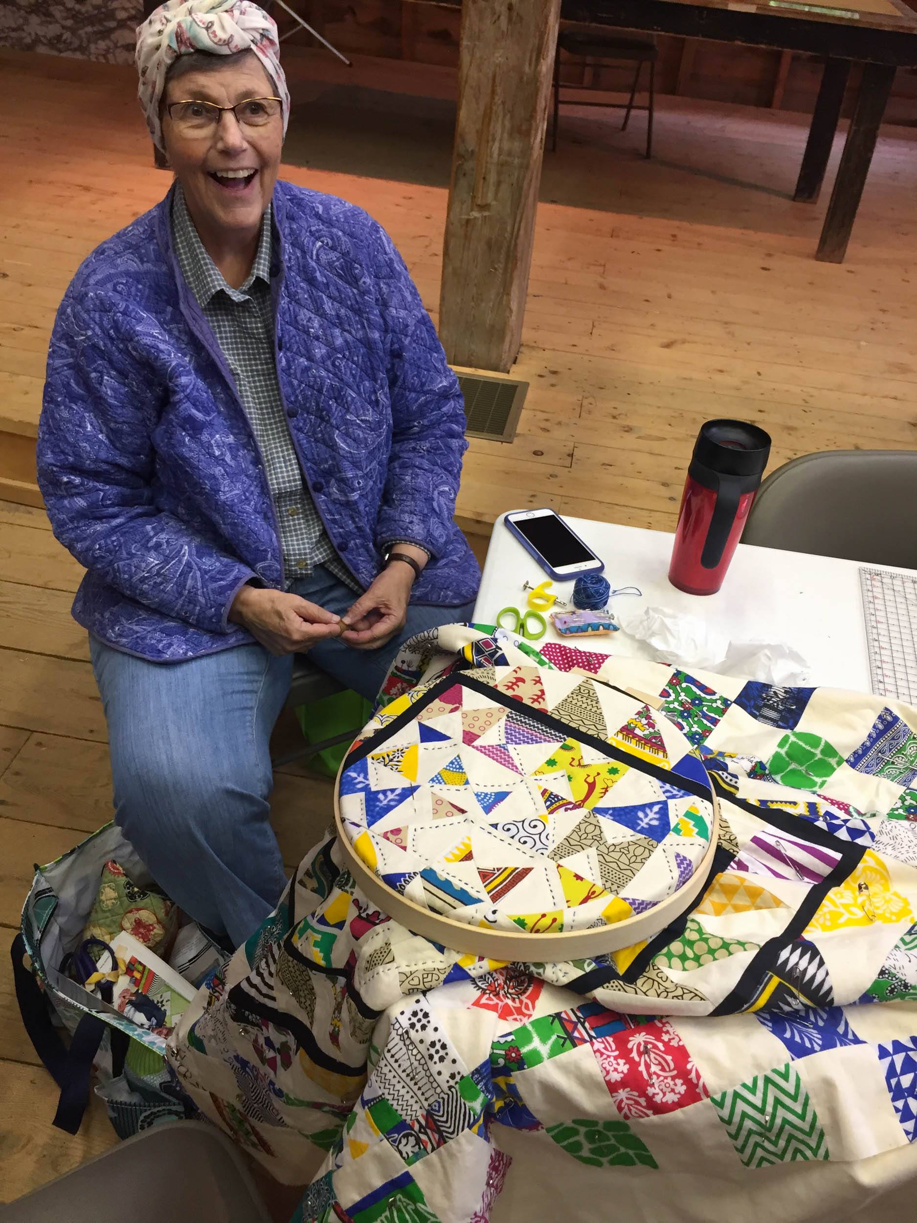 Kathy F and her quilt (1 of 1).jpg