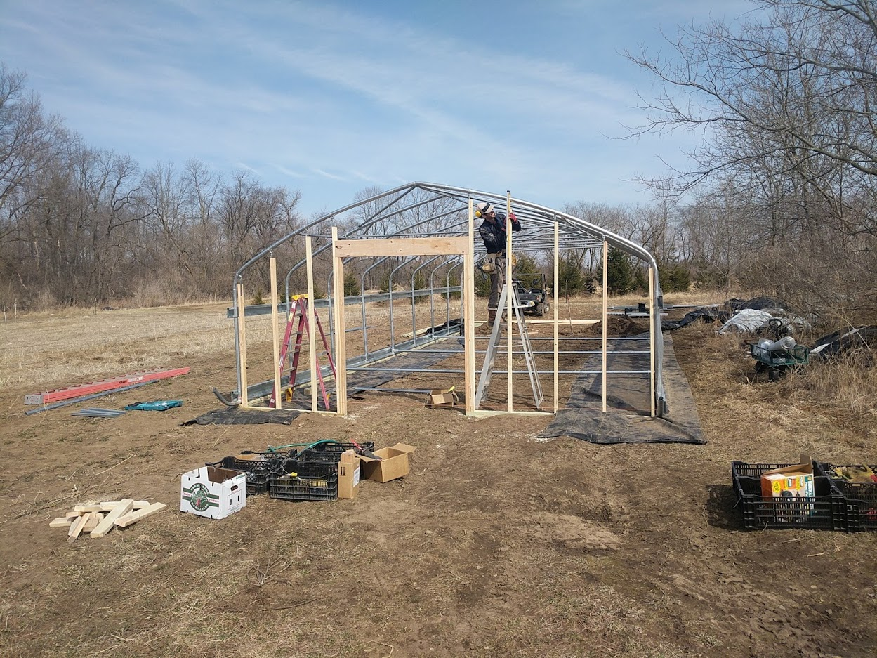 Building the new washing, packing house in the veggie field!