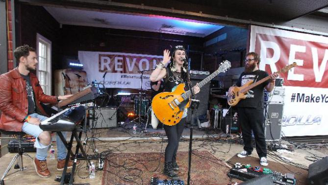 "Hiatus Kaiyote with lead vocalist, Nai Palm center, are seen performing at the ""REVOLT Block Party presented by Toyota #MakeYourMark"" during SXSW Music on Saturday, Mar. 21, 2015 in Austin, Texas. (Photo by Donald Traill/ Invision for Toyota/AP Images)"