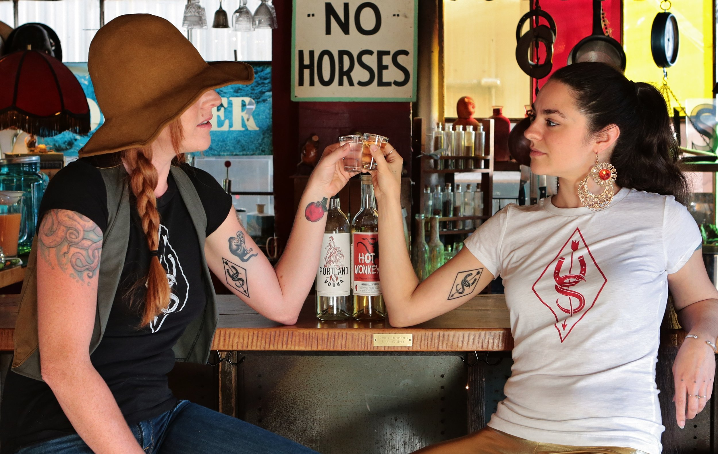 Portland Liquor photo shoot at Underwood Stables showing t-shirts and tattoos of my logo
