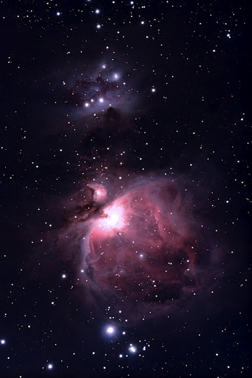 The Orion Nebula or Messier 42 is a virtual factory for stars.  This nebula is a mere 1300 light years from earth.  Hubble has actually imaged some of the primordial stars that are much like our own sun 4.5 billion years ago.