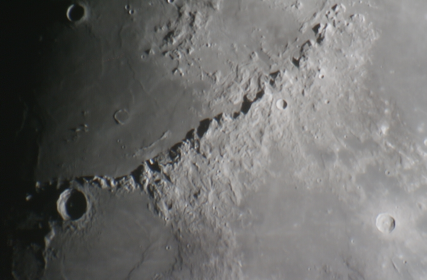 Shadows on the Moon -Mighty Apennine Mountain Range. These moon mountains rise 3-5km above the surface of the moon and were a backdrop of manyApollo 15 moons shots.