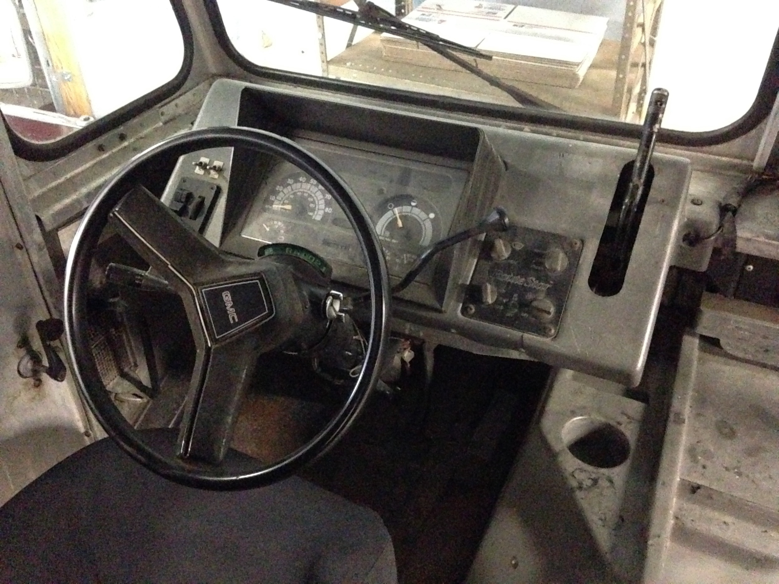 the whole dash is aluminum with some plastic/metal/glass fixtures. Needs a good cleaning.