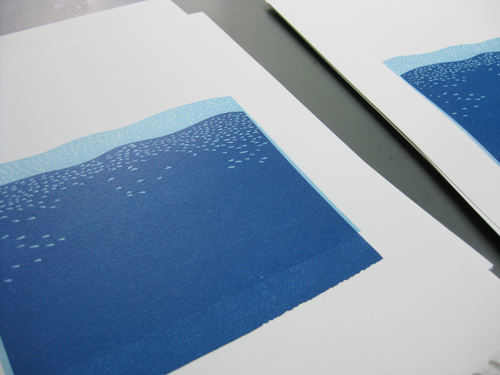 The print with two colors, ready for the third, darkest layer of ink.