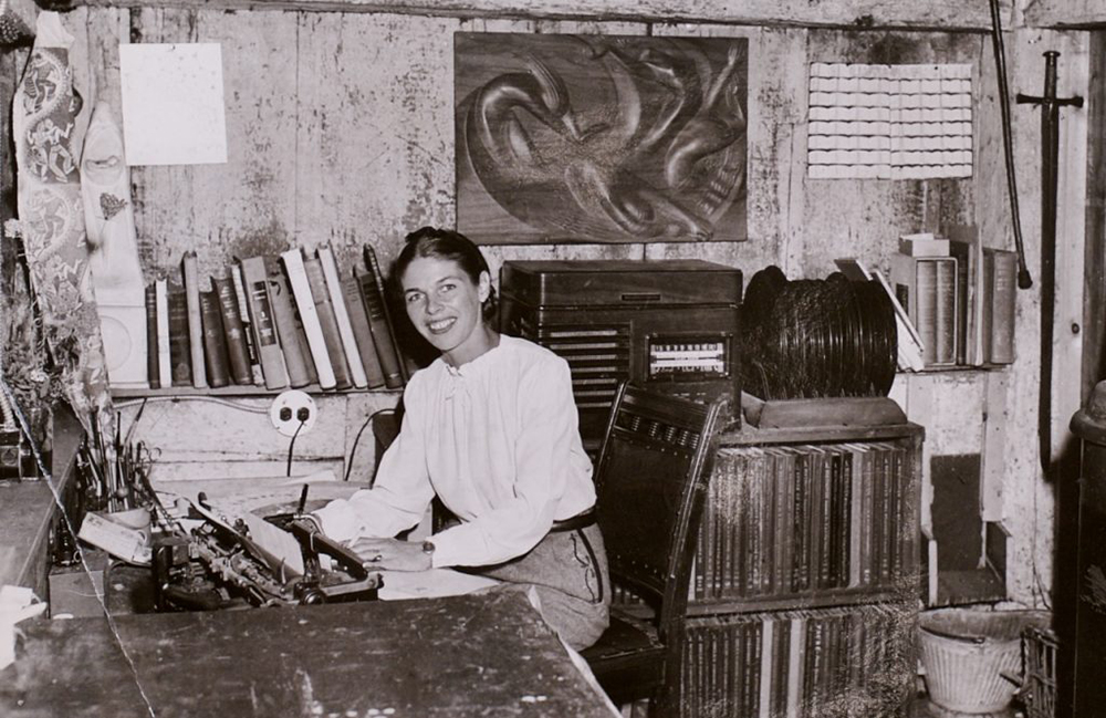 Jinnee Demetrios at her typewriter - the engine who drove the Folly Cove Guild