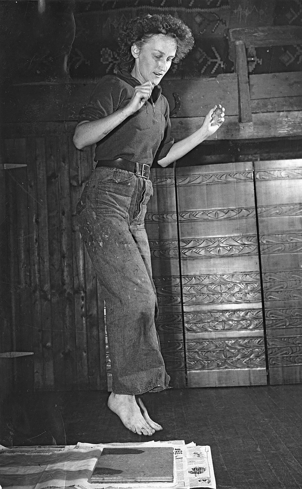 Aino Clarke of the Folly Cove Designers jumps on her linoleum block - before the guild acquired a printing press. Look at those fantastic dungarees!