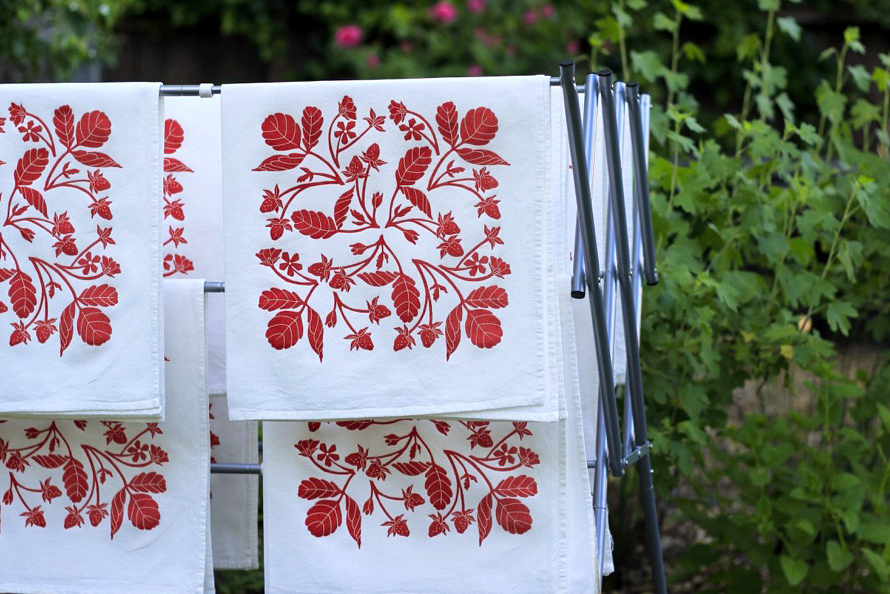 Strawberry tea towels drying in the garden