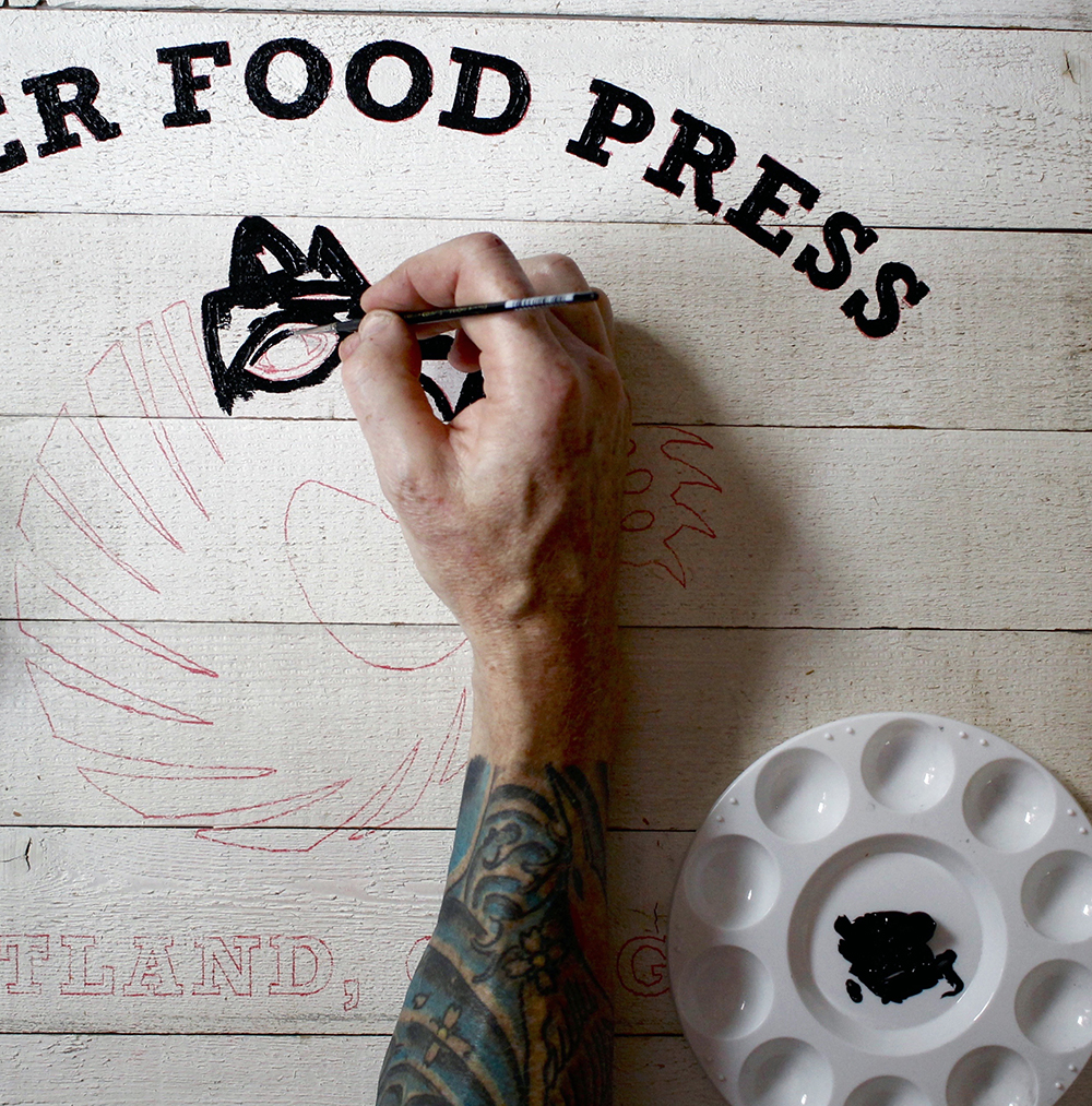 Hand painting the Tiger Food Press sign