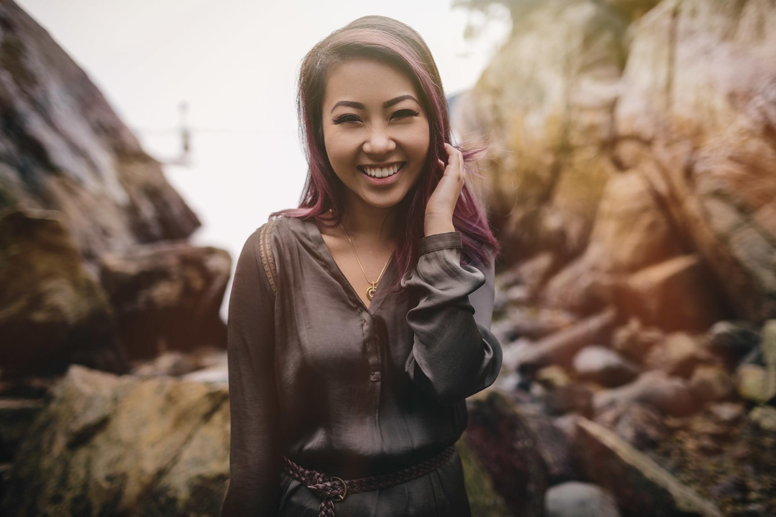 candid smile vancouver portrait photographer with Tien Nguyen whytecliff park