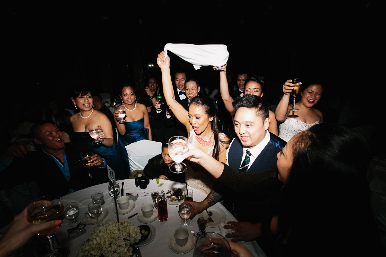 westwood plateau wedding photographer reception table toasting