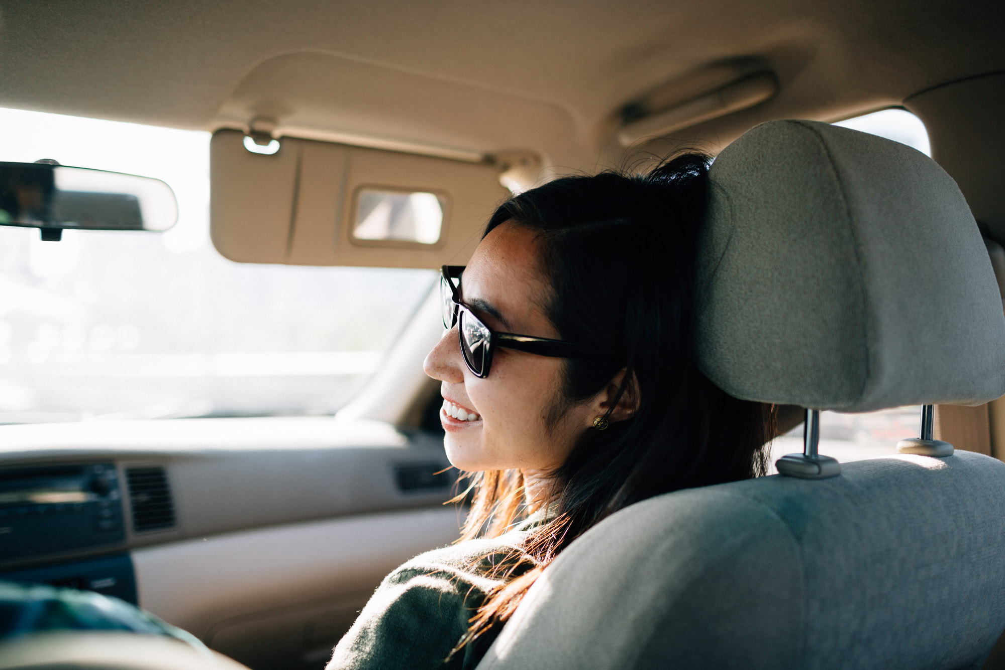 car ride to west vancouver with mytyl engagement photography