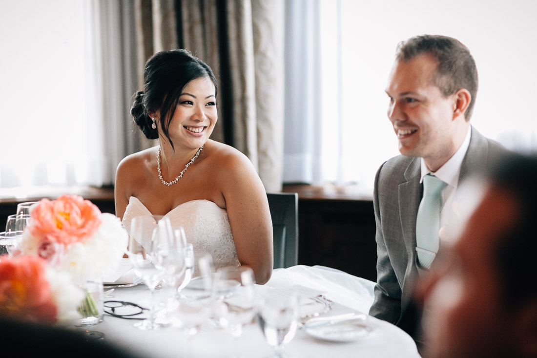 bride looking at groom in the vancouver club during reception in coal harbour wedding photographer