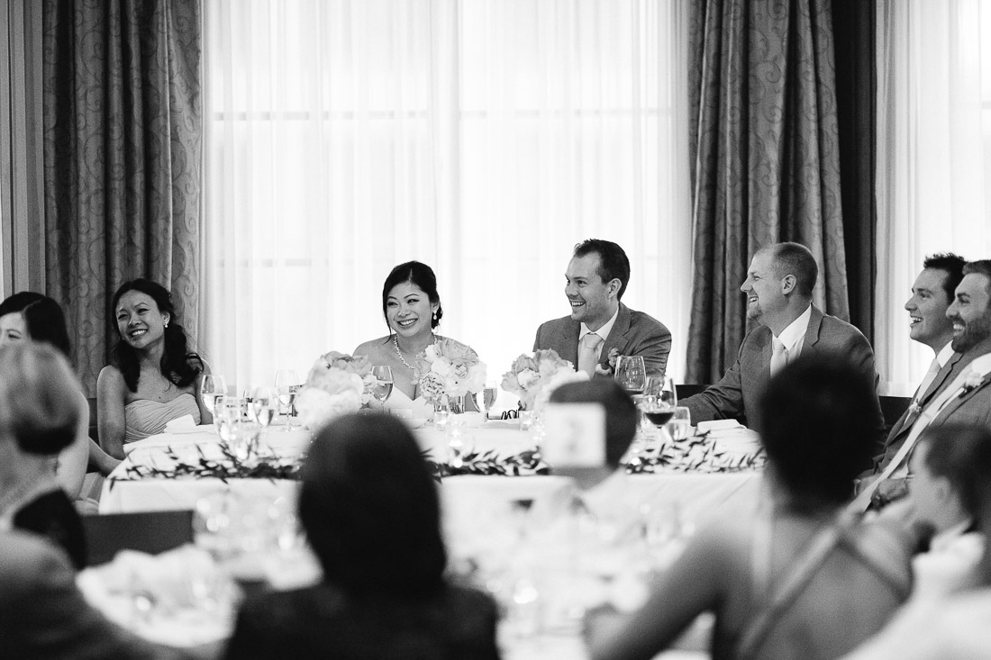 bride and groom listening to speeches at the vancouver club coal harbour wedding photography