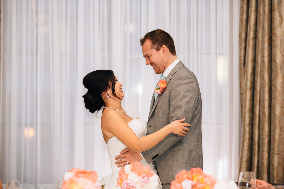 bride and groom embrace at the vancouver club in coal harbour wedding reception
