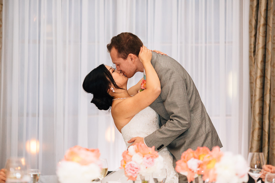 bride and groom kiss at the vancouver club during their wedding reception