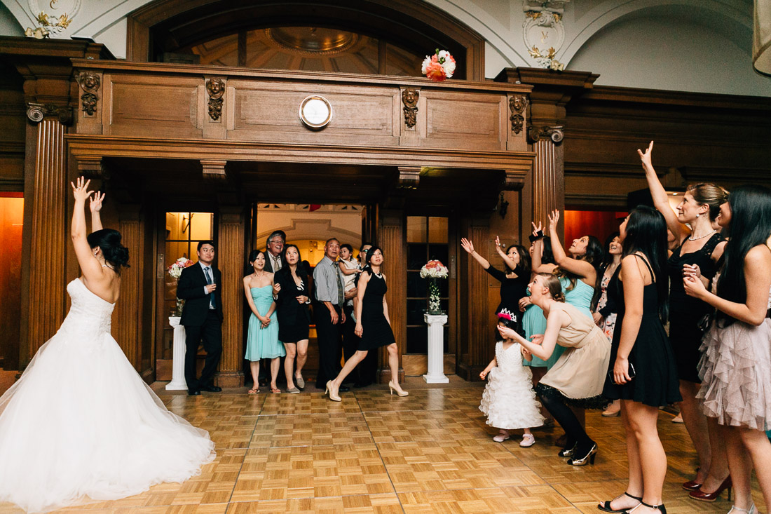 bouquet toss bride at the vancouver club wedding photography