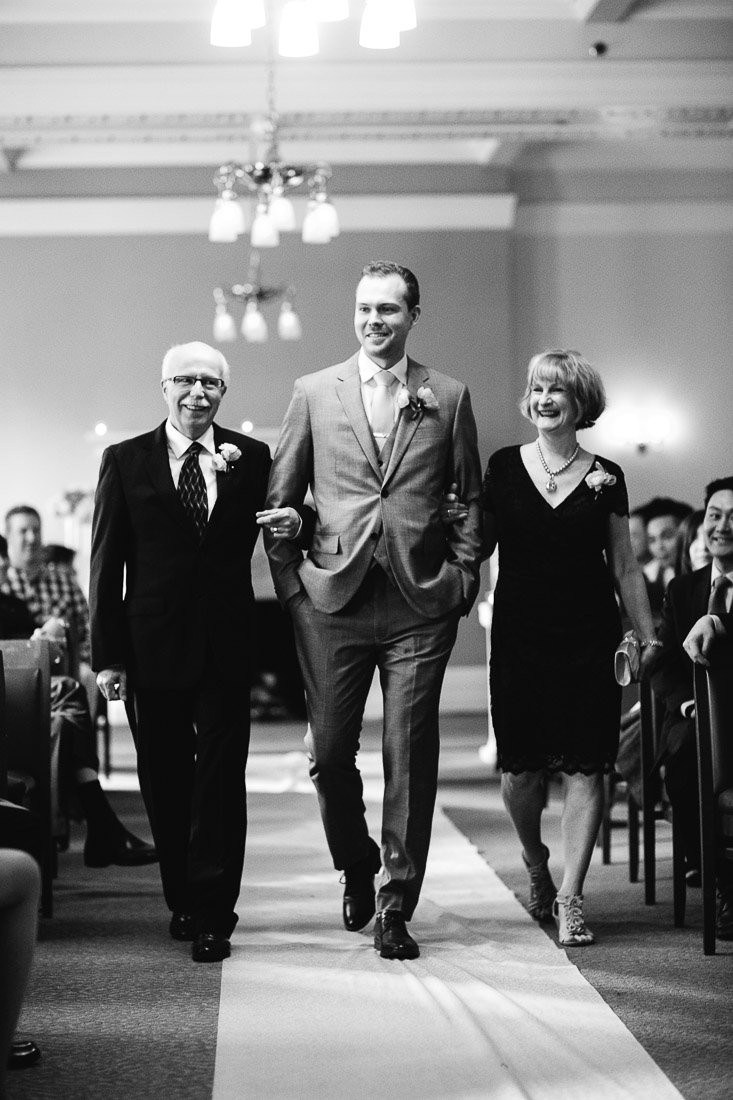 groom walking down the aisle at the vancouver club wedding ceremony