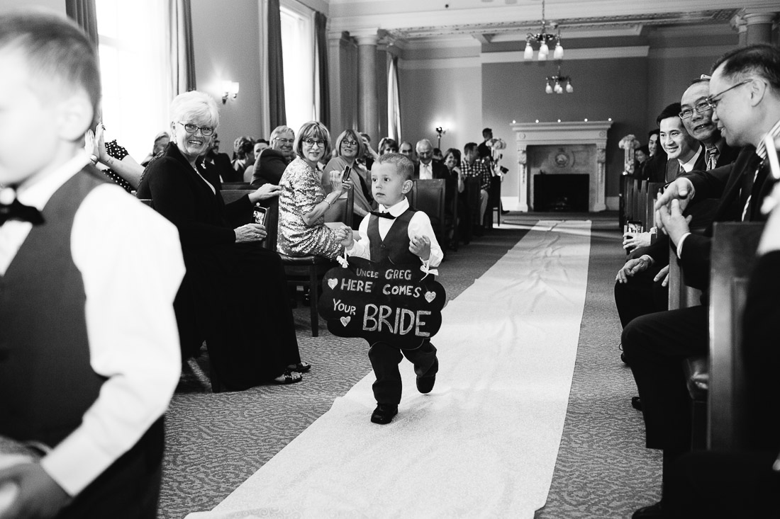 the vancouver club ceremony ring bearer walking down asile