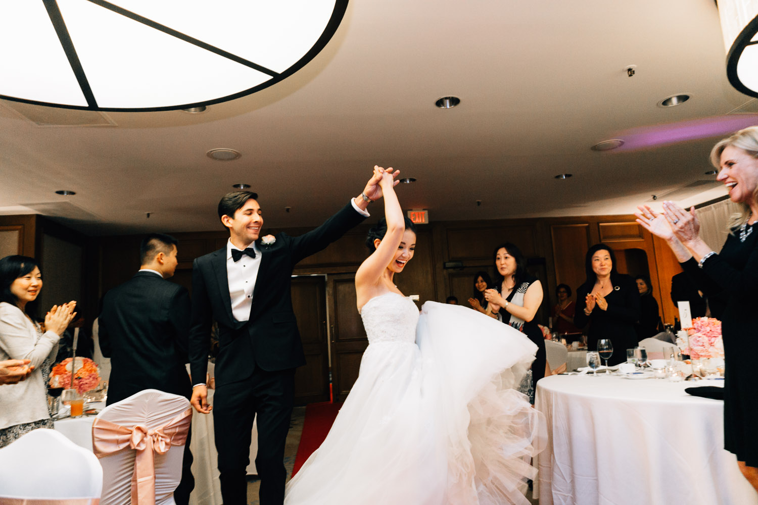 bride and groom ceremony entrance at four seasons hotel in vancouver wedding photography