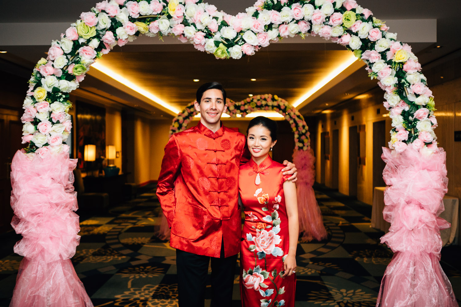 bride and groom portrait in wedding chinese traditional outfits at the Four Seasons Hotel in Vancouver