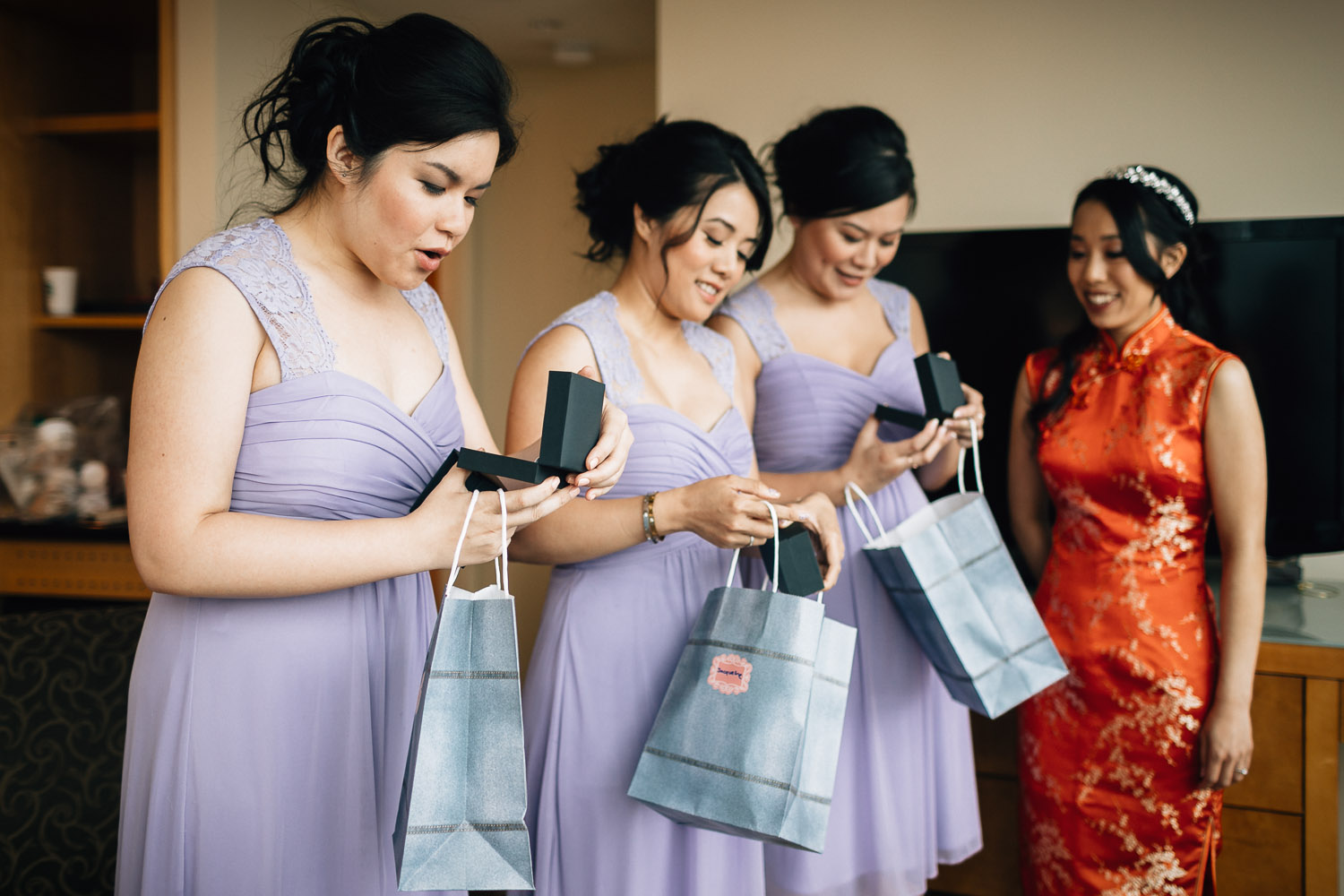 bridesmaids opening gifts at the westin grand hotel in vancouver wedding photography