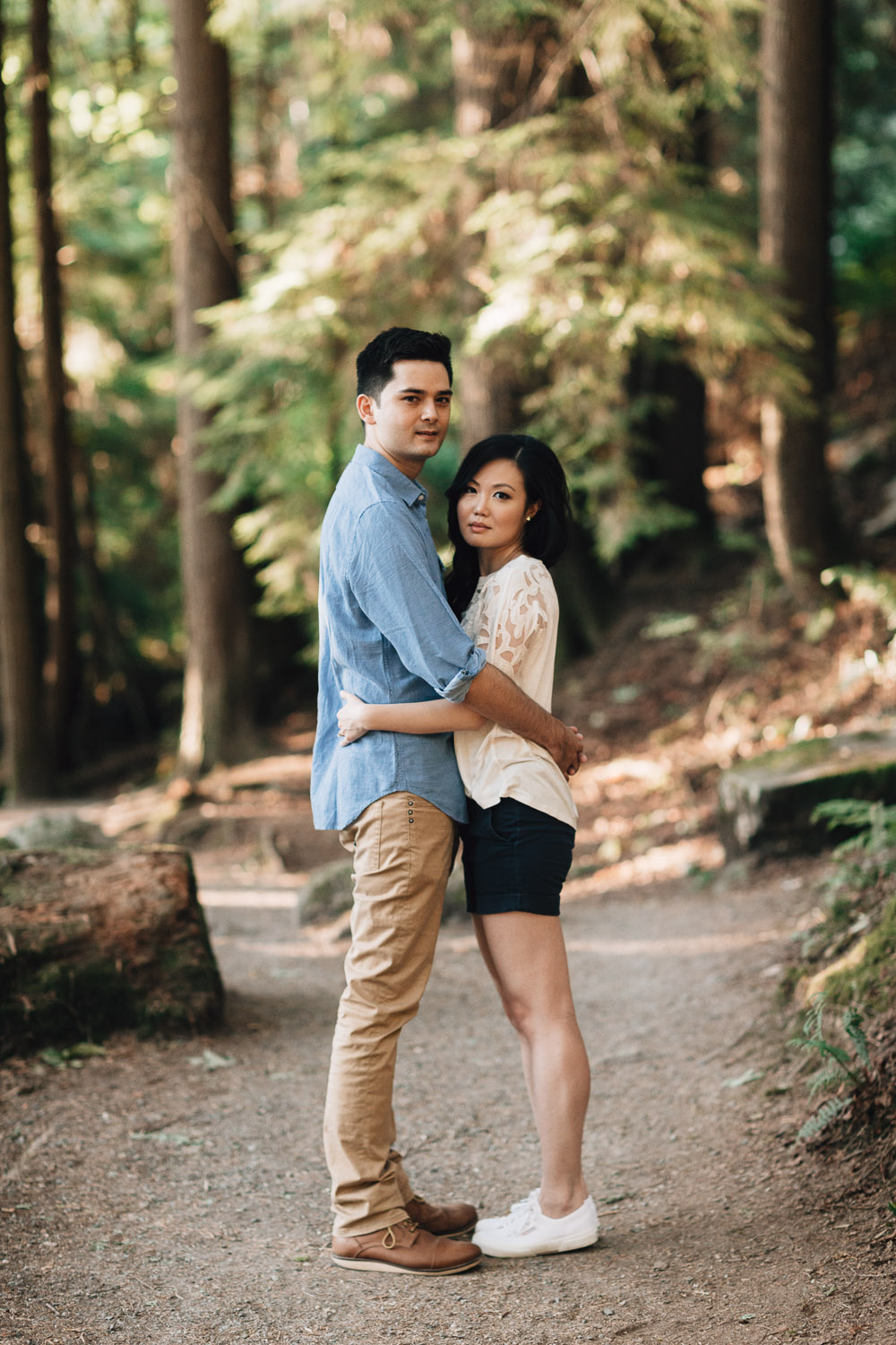 engaged couple in love at sasamat lake in port moody