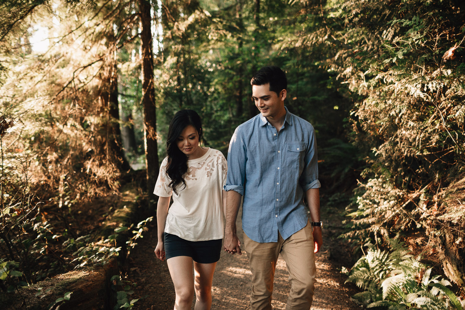 engaged couple walking in love candid vsco at sasamat lake in port moody