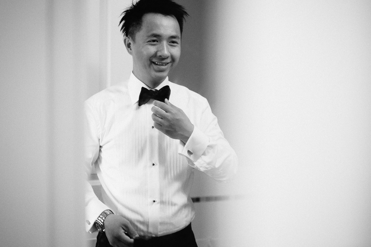 groom getting ready in the mirror vancouver wedding photographer