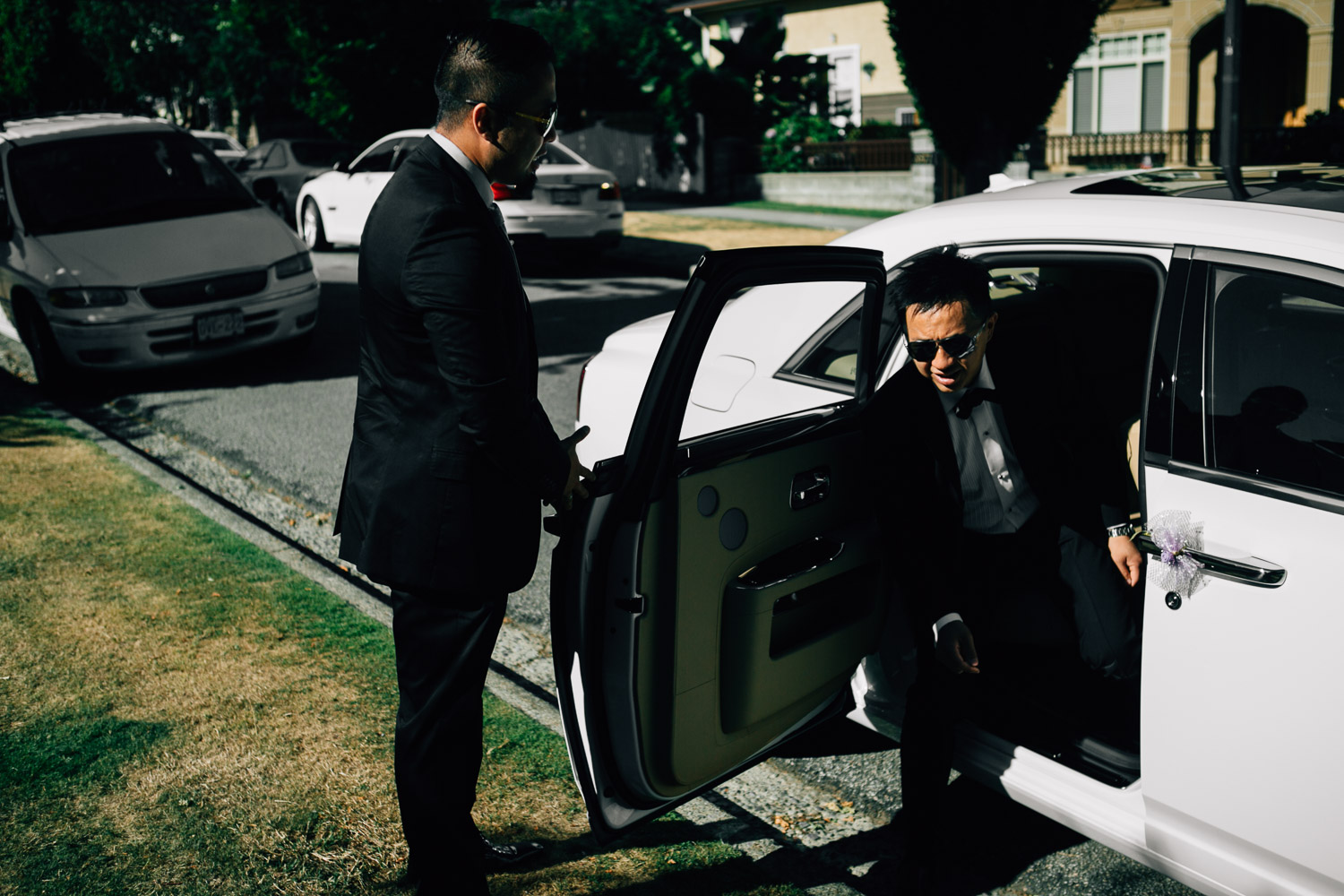 groom getting out of rolls royce vancouver wedding photography